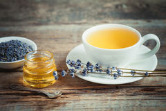 Tea cup, honey, lavender flowers and on background. Stock Photos