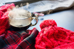 Tea Cup Hot Steam Winter Autumn Time New Year. Tea Cup Hot Steam Tea Window Winter Autumn Time Christmas New Year Tinted Toned Photo Knitting Red Thing Royalty Free Stock Photography