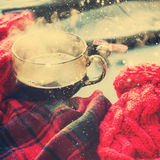 Tea Cup Hot Steam Winter Autumn Time New Year. Tea Cup Hot Steam Tea Window Winter Autumn Time Christmas New Year Tinted Toned Photo Knitting Red Thing royalty free stock images