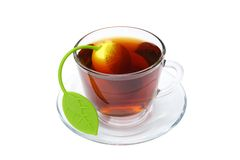 Tea cup with an infuser in it Royalty Free Stock Photography