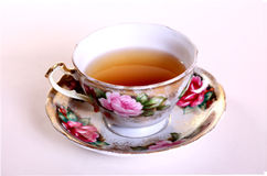 Tea cup. Isolated tea cup with tea against a white backdrop Royalty Free Stock Images
