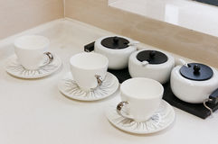 Tea cup in kitchen. White tea cup on white table in kitchen stock images