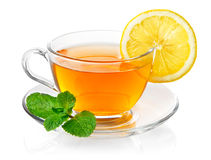 Tea in cup with leaf mint and lemon Stock Image
