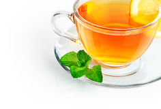 Tea in cup with leaf mint and lemon Royalty Free Stock Photography