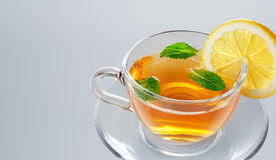 Tea in cup with leaf mint and lemon stock photos