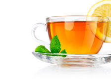 Tea in cup with leaf mint and lemon Royalty Free Stock Images