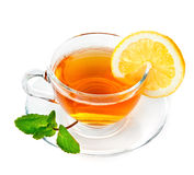 Tea in cup with leaf mint and lemon Royalty Free Stock Image