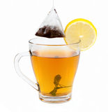 Tea in cup with leaf mint and lemon Royalty Free Stock Photo
