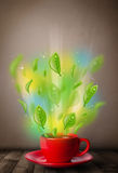 Tea cup with leaves and colorful abstract lights Stock Image