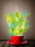 Tea cup with leaves and colorful abstract lights. Close up Stock Photography