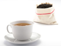Tea in the cup with leaves of tea. Tea in the cup and leaves tea in the sac Stock Images
