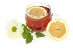 Tea cup and lemon. Tea cup, lemon and flower Royalty Free Stock Photos
