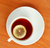 Tea cup with lemon Stock Images