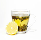 Tea in cup and lemon Stock Photos
