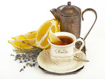 Tea in cup  and lemon Royalty Free Stock Images