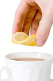 Tea cup and lemon Royalty Free Stock Image