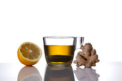 Tea cup lemon and ginger. Tea cup with lemon and ginger shot on a white background Royalty Free Stock Photography