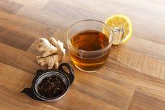 Tea cup lemon and ginger. Tea lemon and ginger on wood landscape Royalty Free Stock Images