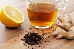 Tea cup lemon and ginger. Tea lemon and ginger on wood landscape Stock Photography