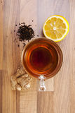 Tea cup lemon and ginger. Tea lemon and ginger on wood top view Stock Photography