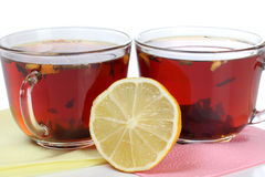 Tea cup and lemon Stock Images