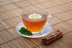 Tea cup lemon. Lemon tea cup mint cinnamon Royalty Free Stock Images