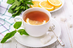 Tea. Cup of tea with lemon on a white wooden table Stock Photos