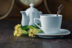 Tea cup and Linden blossom Stock Photo