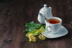 Tea cup and Linden blossom Stock Photos