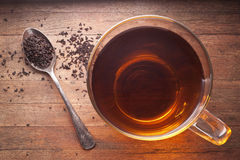 Tea Cup. A cup of tea with loose-leaf tea and a teaspoon, photographed from above Royalty Free Stock Images