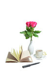 Tea cup of love , handmade book , pen and pink rose in vase Royalty Free Stock Images