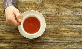 Tea cup male hands holding cafe table wooden top view Royalty Free Stock Photos