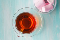 Tea cup and marshmallow Stock Image