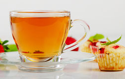 Tea cup and muffins Stock Image