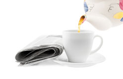 Tea cup with newspaper Royalty Free Stock Photos