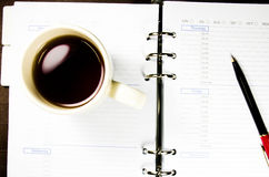 Tea cup with notebook Royalty Free Stock Photos