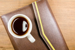 Tea cup with notebook Royalty Free Stock Images