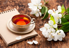 Tea Cup, Notebook And White Spring Flowers Royalty Free Stock Photo