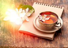 Tea Cup, Notebook And White Spring Flowers Royalty Free Stock Photography