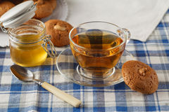 Tea cup with oatmeal cookie on dark wooden table covert tableclo Stock Image