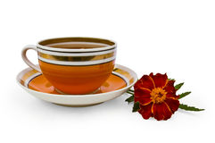 Tea in a cup of orange marigolds Royalty Free Stock Images