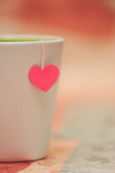 Tea cup with paper heart. Valentine's mug with pink handmade heart Stock Photo