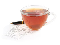 Tea cup and pen on plan Royalty Free Stock Photo