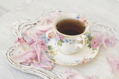 Tea cup with peony petals Royalty Free Stock Photos
