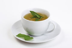Tea cup with peppermint. A cup of mint tea with peppermint (mint) leaves on a white background stock photo