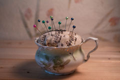 Tea Cup Pin Cushion. With pins Royalty Free Stock Image