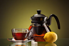 Tea cup and pot Stock Images
