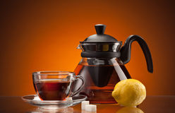 Tea cup and pot Stock Image