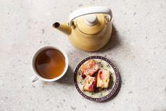 Tea cup, tea pot and freshly baked sponge cake royalty free stock photography