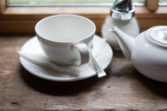 Tea cup pot and sugar on wood table Stock Photos